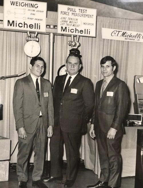 Michelli History - Photo of Ron Michelli, G.T. Michelli, and G.T. Michelli Jr. at the International workboat trade show