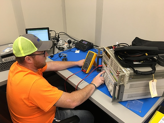Michelli technician performing an electronic calibration