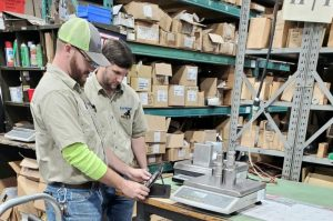 Michelli calibration technicians perform calibration on counting scale
