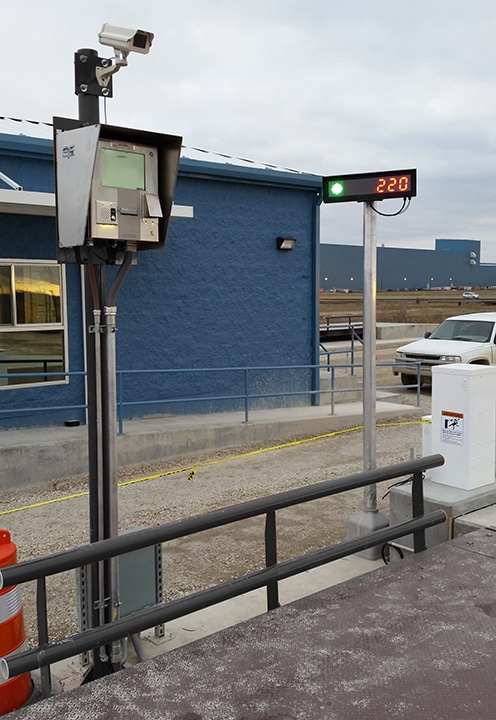 Unmanned truck scale kiosk with camera & remote scoreboard display