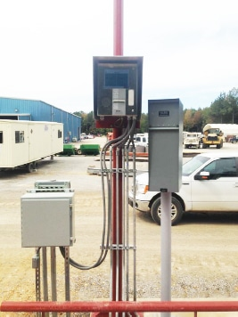 Unmanned truck scale kiosk with remote scoreboard display