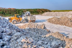 Truck being loaded with gravel in a gravel pit