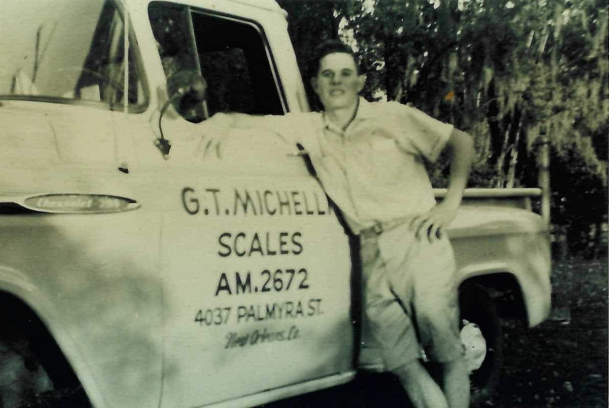 G.T. Michelli Jr. poses with his father's service truck