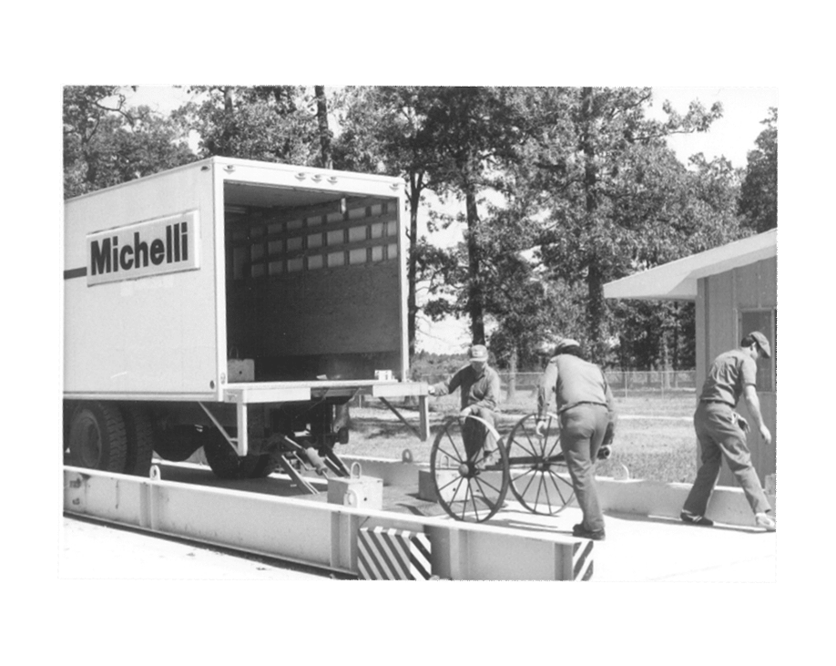 Michelli History - Michelli team members calibrate a truck scale using equipment they carried in a rented truck