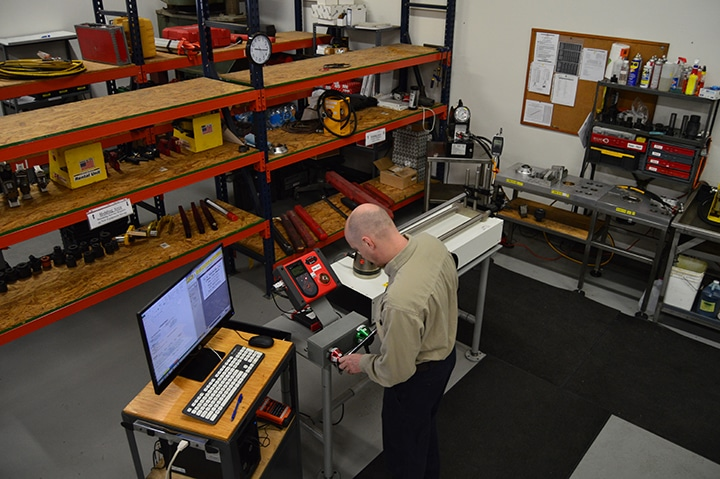 Calibration technician works at the torque calibration bench