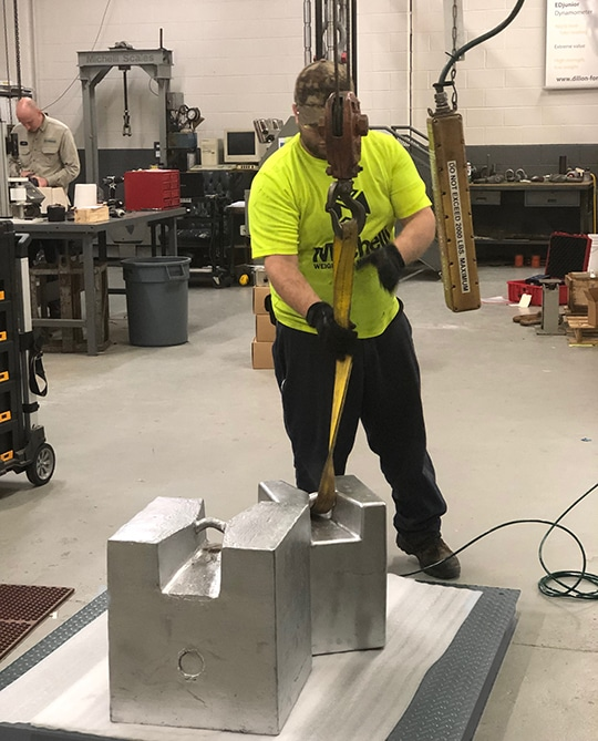 Michelli Weighing & Measurement technician performs floor scale calibration