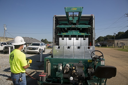 Michelli Weighing & Measurement technician uses remote to pull test cart out of heavy duty test truck