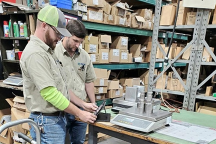 Michelli Weighing & Measurement technicians perform scale calibration on site