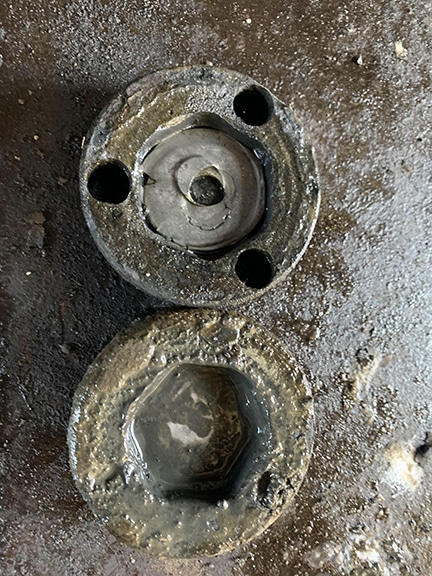 Rail scale receiver cup with squashed nut inside